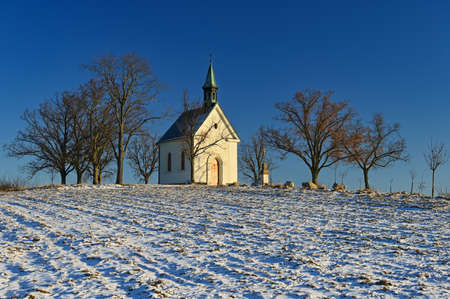Beautiful winter landscape with church. Sunny winter day. Brno