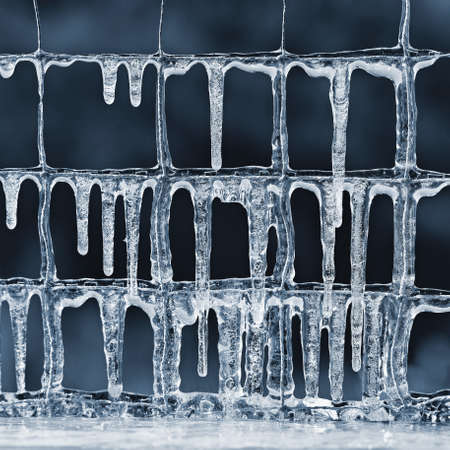 Beautiful icicles in winter. Concept for winter and frost. Banco de Imagens - 164195681