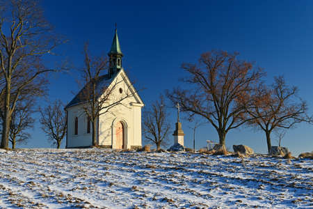 Beautiful winter landscape with church. Sunny winter day. Brno - Líšeò. Chapel of Our Lady of Helper.