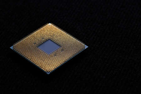 Processor to the computer. Concept for technology and computing. Detail of connectors. CPU Chip Processor for tech science background.