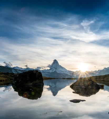 sunset at Matterhorn with reflection in Stellilake in the late afternoon