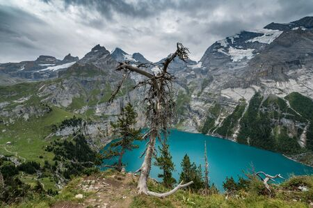 view of turquoise Lake Oeschinensee from high above in the Swiss Alps
