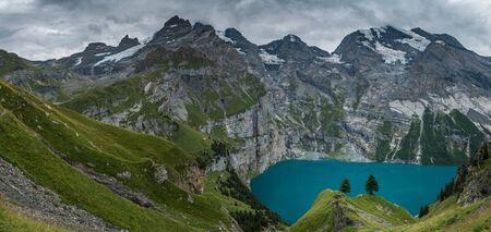 panoramic view of Lake Oeschinensee, Blümlisalphütte and Blümlisalp-Massiv