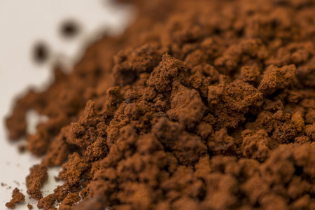Close up to brown granulate of instant coffee photo