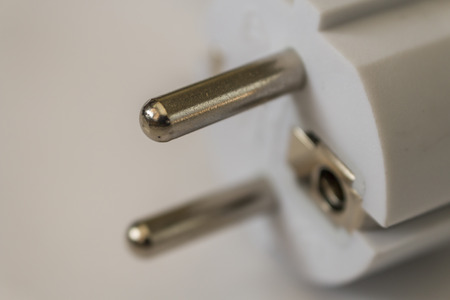 white electric plug  on white background photo