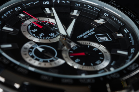 luxury man accessory watch detail, chronograph macro