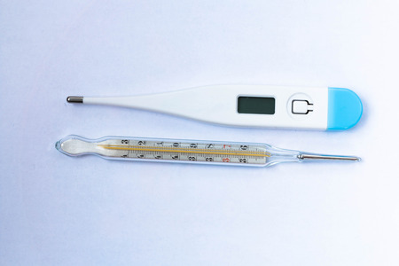 quicksilver: Mercury and digital thermometer on white background Stock Photo