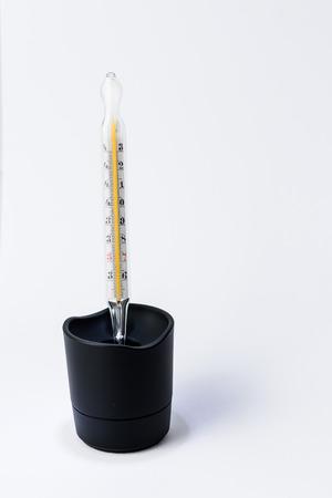 quicksilver: Mercury thermometer in black  box on white background Stock Photo