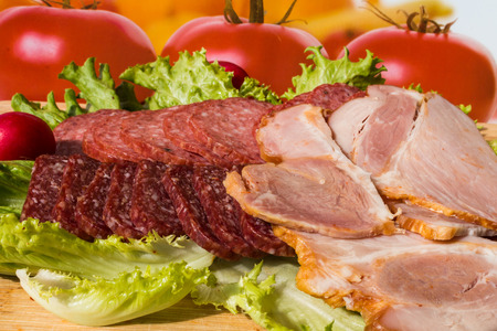 salam: Cut pieces of smoked salam and ham with lettuce