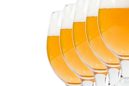 glasses of beer on a white background photo