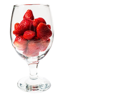 juicy red strawberries in a glass photo