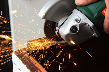 angle: Angle grinder sparks close-up