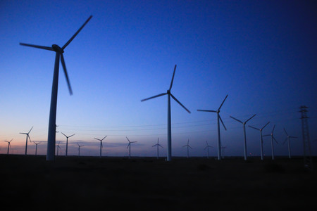Wind turbines at sunset, Black Sea, Bulgaria Standard-Bild
