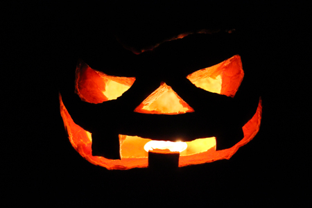 Scary Halloween pumpkin lit in the dark Stock Photo