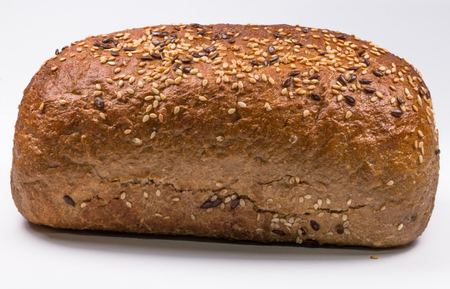 fresh baked bread with seeds on white background