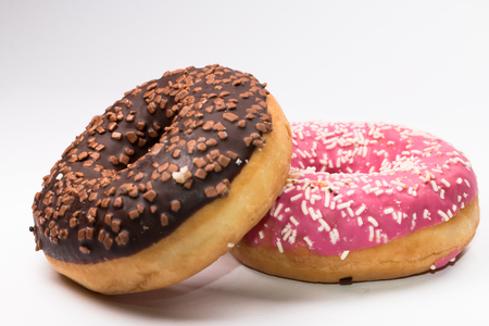 pink brown: pink and brown donuts on white