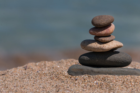 Balanced stones near the beach Stock Photo