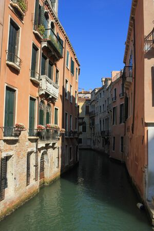 View of the old buildings and canals of Venice, Italy Standard-Bild - 131712392
