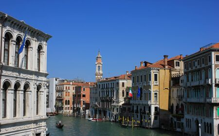View of old historic and residential buildings along the Grand Canal, Venice, Italy Standard-Bild - 131712484
