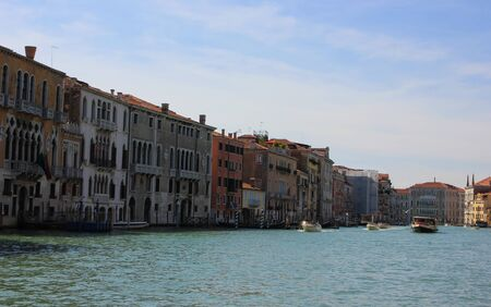 View of old historic and residential buildings along the Grand Canal, Venice, Italy Standard-Bild - 131712508