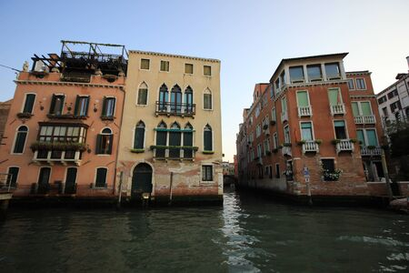 View of old historic and residential buildings along the Grand Canal, Venice, Italy Standard-Bild - 131712591