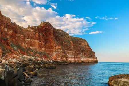 Red rock near the sea.Bolata beach, near cape Kaliakra, Black Sea ,Bulgaria Standard-Bild - 131712851