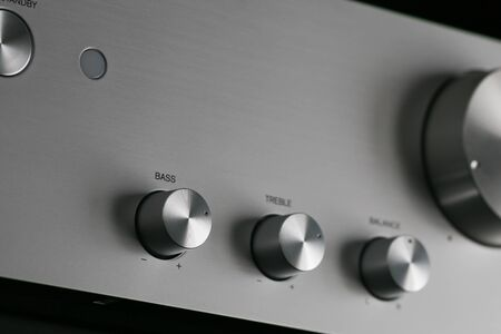 Control Knobs on a Silver Metallic Amplifier - Shallow Depth of Field
