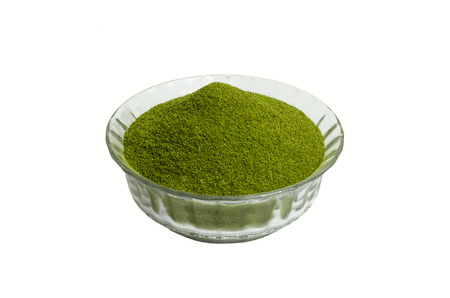 dry powder: Moringa  oleifera dry powder  in a white background