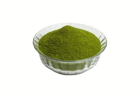 Moringa  oleifera dry powder  in a white background