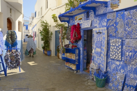 Woman walking on the streets of Asilah, Morocco.