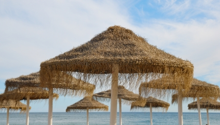 Straw umbrellas on Marbella beach Stock Photo - 16760809