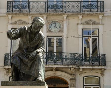 chiado: Bronze sculpture in memory of Antonio Ribeiro, poet from Evora in the Chiado Square, Lisbon, Portugal