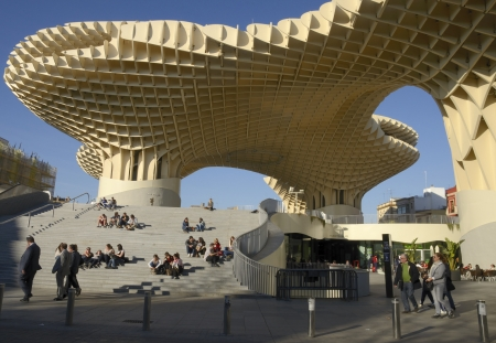 Metropol Parasol is a primarily wooden building located at La Encarnaci�n square, in the old quarter of Seville, Spain. It was designed by the German architect J�rgen Mayer-Hermann