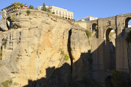 The New Bridge in Ronda, Spain, is the tallest of the bridges, towering 120 metres above the canyon floor, and all three serve as some of the city Stock Photo - 24478693