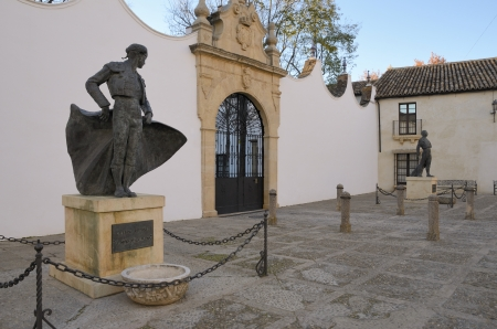 bullfighters: Statues of famous bullfighters in front of bullring round in Ronda, Andalusia, Spain