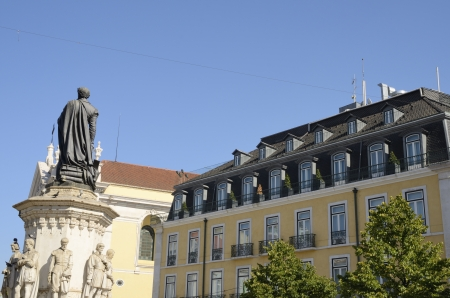 bairro: This small square is the transition zone between Chiado and Bairro Alto in Lisbon, Portugal. In its center is a monumental statue of 16th century epic poet Luis de Camoes standing on a pedestal with other smaller statues of classical Portuguese authors.