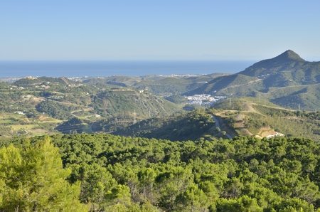View of the village of Benahavis in Andalusia, Spain and the Mediterranean sea