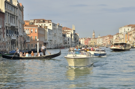 A lot of boats sailing on the Grand Canal in Venice.