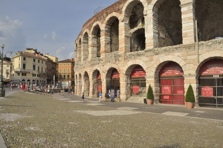 The Verona Arena  is a Roman amphitheatre  in Verona, Italy built in 30 AD. It is still in use today and is internationally famous for the large-scale opera performances given there. It is one of the best preserved ancient structures of its kind.