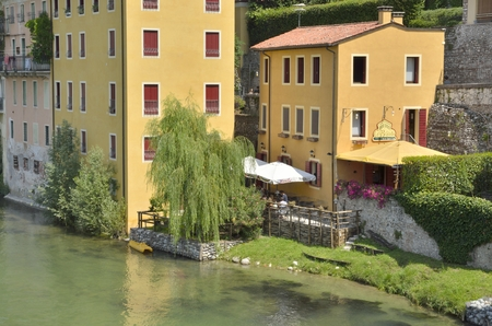 grappa: Restaurant next to the river Brenta in the city of  Bassano del Grappa, northern Italy