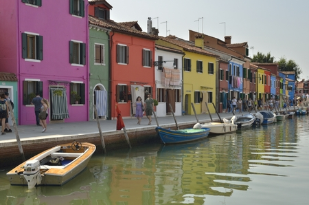 Colorful houses along a canal in Burano, an island of Venice, Italy