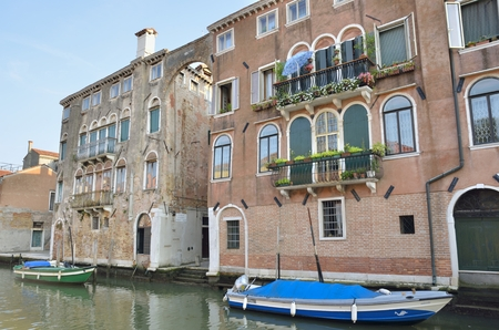 sestiere: Houses on a canal in Cannaregio,  the northernmost of the six historic districts of Venice. It is the second largest sestiere by land area.