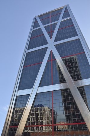 One of the twin Kio towers,  The towers are office buildings in Madrid, Spain .They were designed by the American architects Philip Johnson and John Burgee, commissioned by the Kuwait Investment Office (hence their initial name). Each building is 115 metr