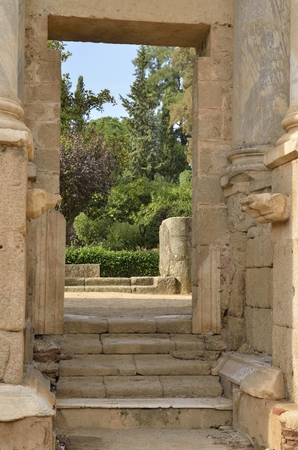 archaeological sites: Gate to the gardens in  in the Roman Theatre of Merida. The theatre is located in the archaeological ensemble of Merida, one of the largest and most extensive archaeological sites in Spain.