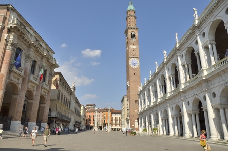 lords: Bissara Tower rises above the Square of the Lords, the main square of Vicenza in the Veneto region of northeast Italy. The clock on the tower was designed by 14th century architect and sculptor Andrea Pisano Editorial