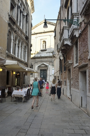 Tourists walk along a street in Venice, Italy, where is situated the church of San Silvestro Editoriali