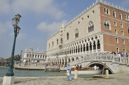doge: People around the Doge Palace,  built in Venetian Gothic style, and one of the main landmarks of the city of Venice, northern Italy. Editorial