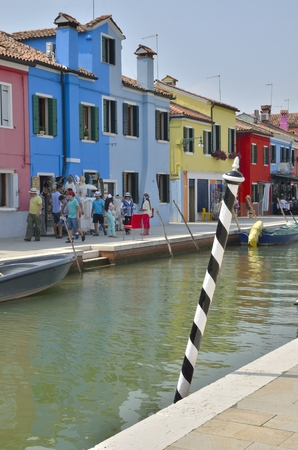 Murano: Some people walking along a small canal in Murano, an island in the Venetian Lagoon, northern Italy.