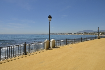 Promenade beach along the Mediterranean sea in Marbella, Andalusia, Spain Stock Photo