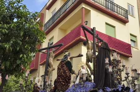 holy week in seville: Image of Virgin Mary at the feet of Jesus  crucified on the cross in the holy week of Seville. That is one of the most imported traditional events of the city And Also the Most Important Holy Week in Spain.